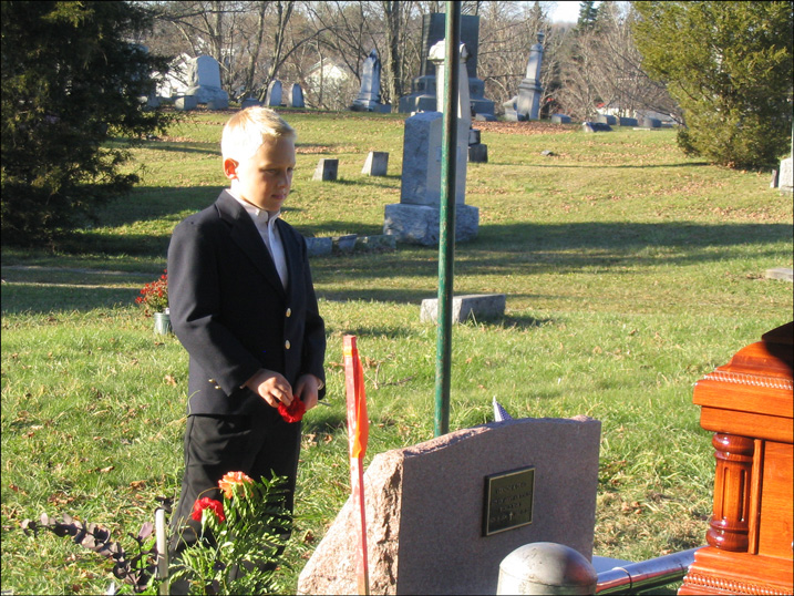 Lukas Graig at His Grandmother's Graveside