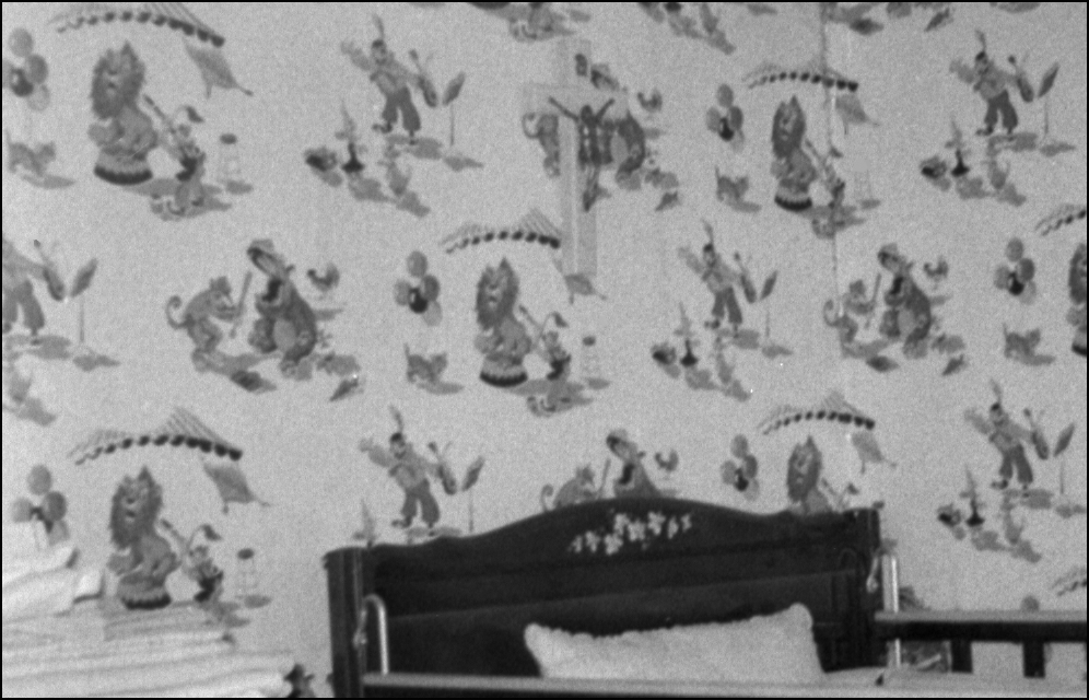 The Wallpaper and Crucifix on the Walls of My Sister's Bedroom