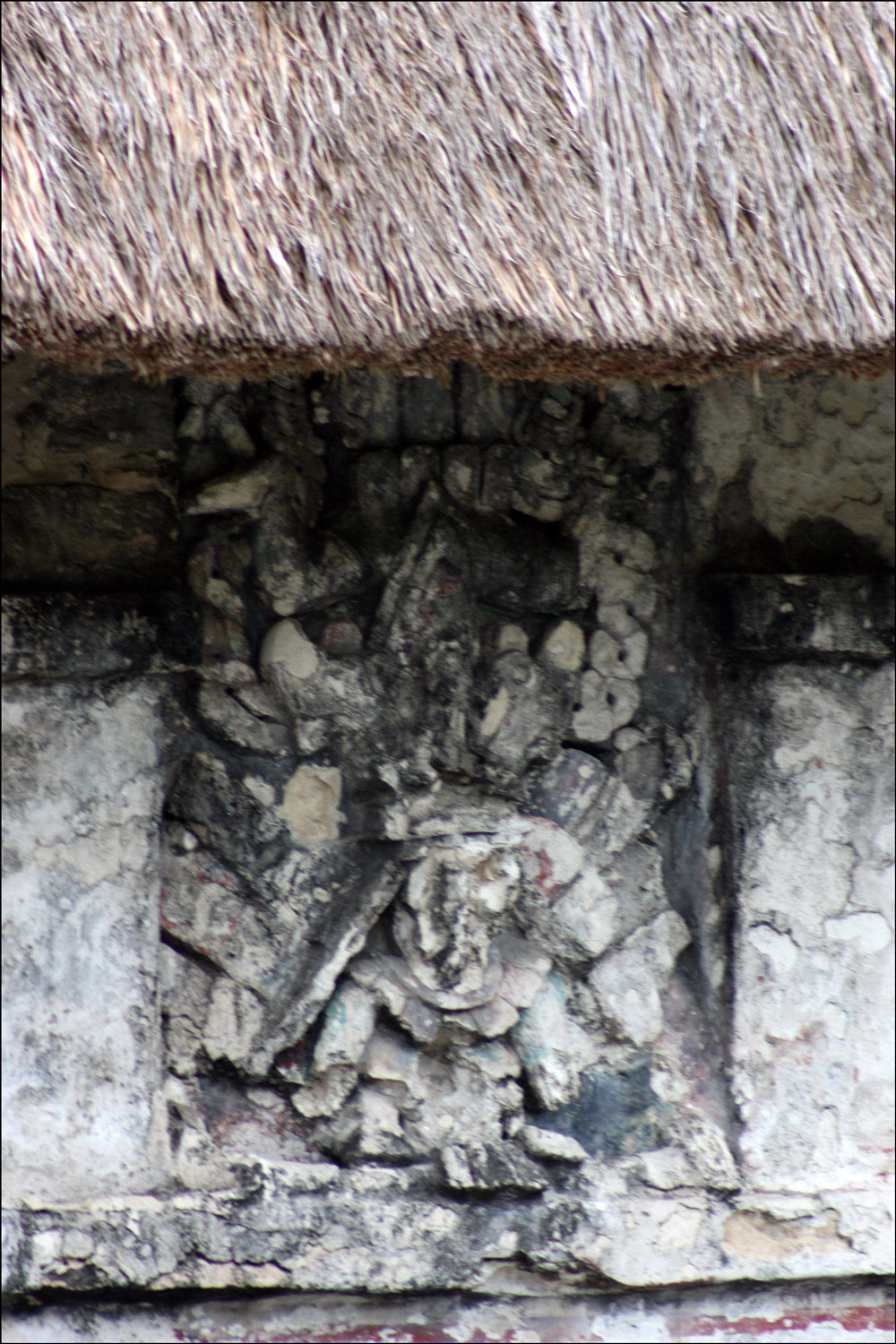 Carving on the House of the Halach Uinic in Tulum