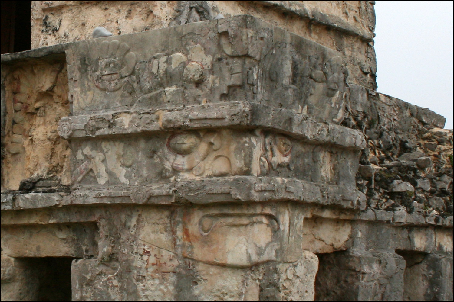 Face Carved on the Corner of the Temple of the Frescos